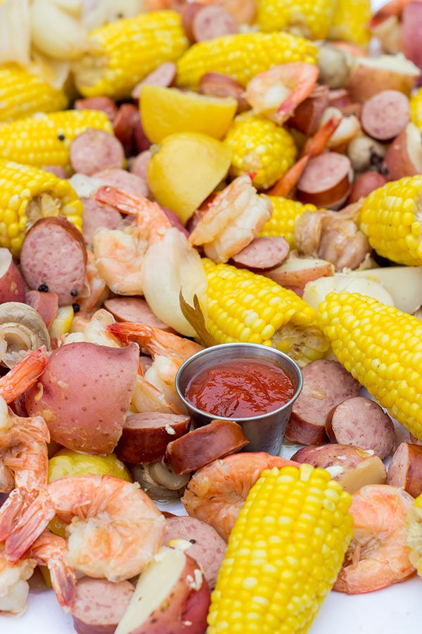 A Lowcountry Boil is a classic Southern recipe famous along the South Carolina coast. This combination of shrimp, sausage, corn and potatoes is ideal for a backyard party with friends!