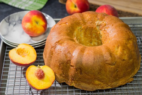 This Fresh Peach Pound Cake is packed with the flavor of summer! Grab a slice and enjoy it on the back porch this weekend!