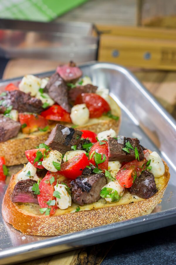 Looking for a fun summer grilling recipe? Grab some steak and tomatoes and whip up a batch of this Grilled Steak and Tomato Crostini!