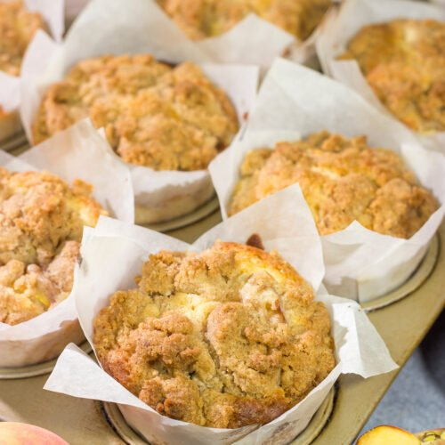 Filled with juicy peaches and topped with a brown sugar crumble, these Peach Streusel Muffins are a tasty treat for summer mornings!